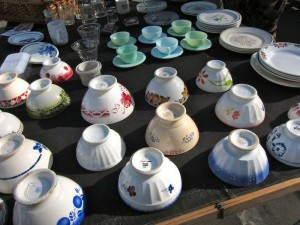 Stand selling tableware at Marché aux Puces de la Porte de Vanves