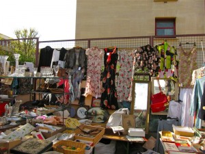 Stand at Marché aux Puces de la Porte de Vanves selling vintage clothing