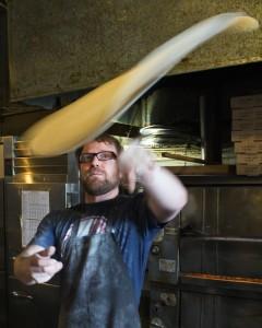 Vinos Brewpub thrown dough by Kat Robinson