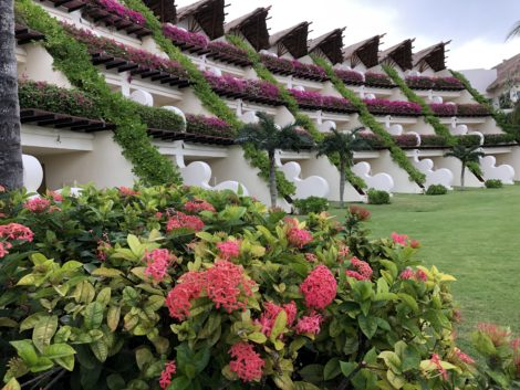 Back view of the flower-filled Grand Velas Riviera Maya resort.