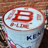 Barrel painted with B-Line Logo