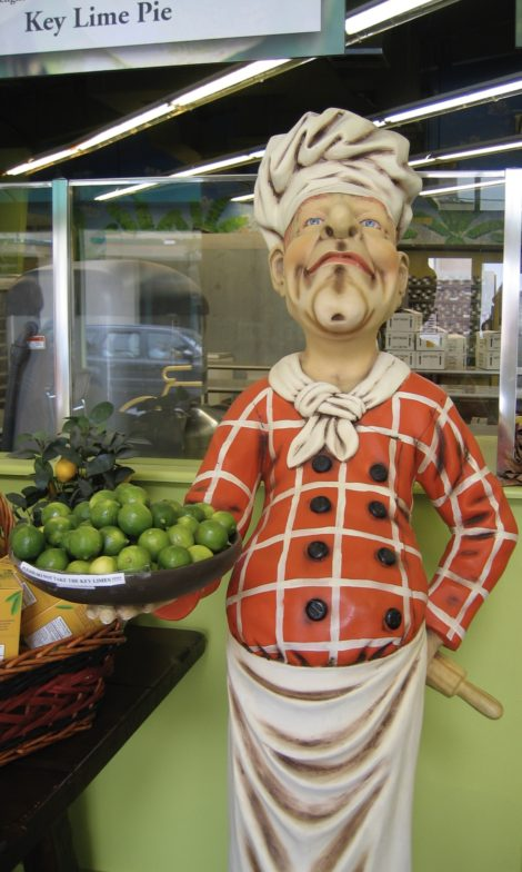 Statue of chef holding a platter of key limes.