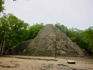 Nohoch Mui Pyramid surrounded by jungle.
