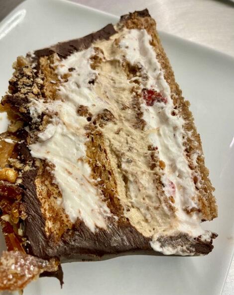 Piece of Walnut Marjolaine with Cappuccino & Strawberry Mousse , Chocolate Ganache & Walnut Brittle