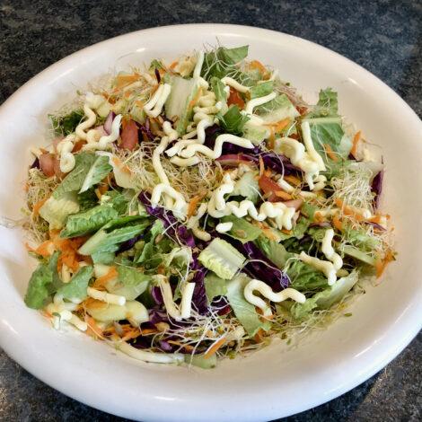 Sunshine Inn salad in large white bowl.