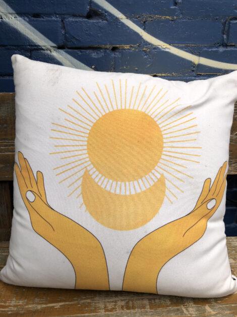 Sunshine motif on throw pillow at Edobox.