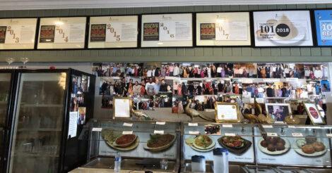 Wall of awards and photos inside Mayura